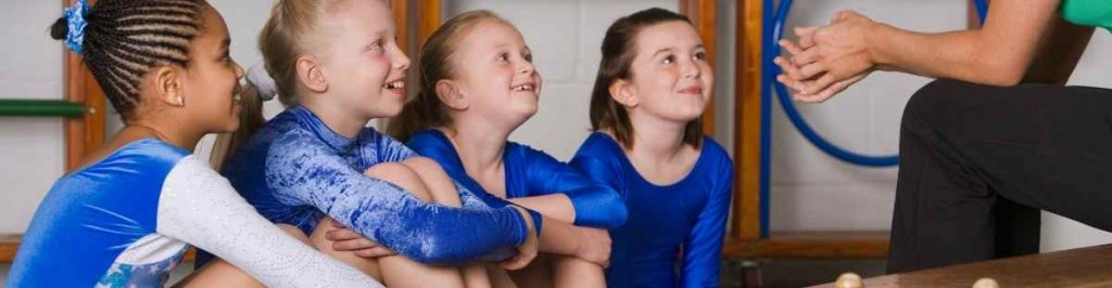 Gilrs learning gymnastics in Cairns